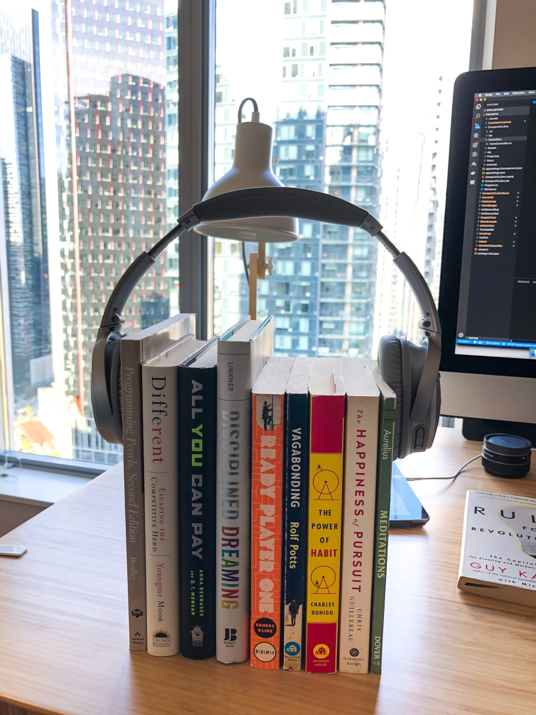 Books wrapped by headphones